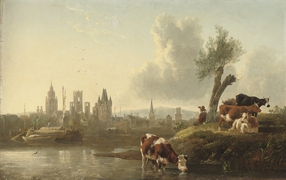 A river landscape with cattle