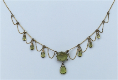 AN ANTIQUE PERIDOT AND DIAMOND