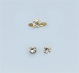 A DIAMOND SINGLE STONE RING AN