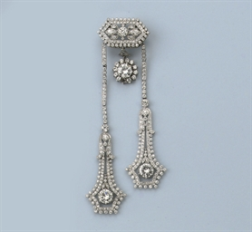 A FINE DIAMOND NEGLIGÉ BROOCH