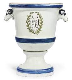 A CONTINENTAL FAIENCE URN