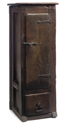 AN OAK NARROW DWARF CUPBOARD