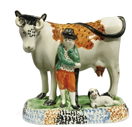 A PRATT WARE MODEL OF A COW AN
