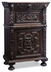 A FLEMISH OAK CUPBOARD
