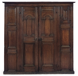 A GERMAN OAK VESTRY CUPBOARD