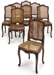 A SET OF EIGHT FRENCH OAK DINI