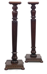 A PAIR OF MAHOGANY TORCHERES