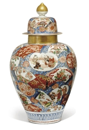 A JAPANESE IMARI JAR AND COVER
