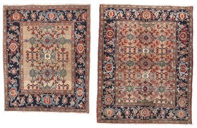 A near pair of Heriz rugs
