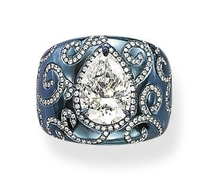 A STYLISH TITANIUM AND DIAMOND RING, BY J. KOO