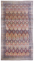 A LARGE KIRMAN CARPET