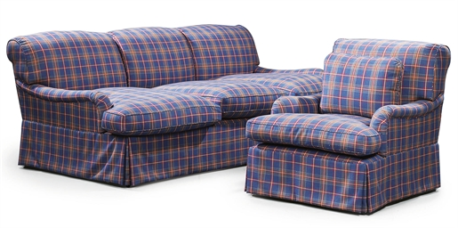 A THREE SEAT SOFA AND ARMCHAIR