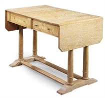 A HEAL'S LIMED OAK WRITING TABLE