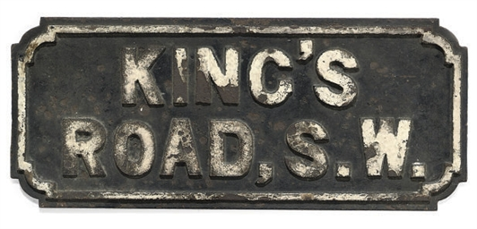 AN IRON STREET SIGN FOR THE KI
