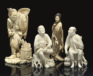 A group of four ivory okimono,
