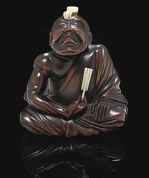 A wood okimono style netsuke,