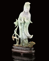 A JADEITE CARVING OF GUANYIN,