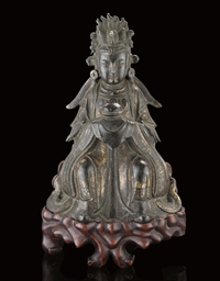 A BRONZE MODEL OF GUANYIN, 17T