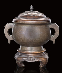 A SILVER INLAID BRONZE CENSER