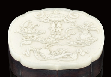 A WOOD BOX WITH CARVED WHITE J