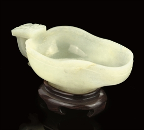 A WHITE JADE POURING VESSEL, 1