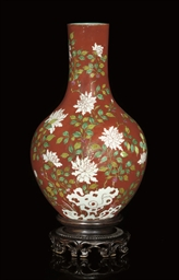 A CORAL GROUND BOTTLE VASE, 19