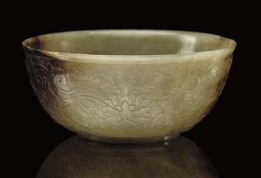A CELADON AND RUSSET JADE BOWL