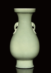 A CELADON BALUSTER VASE, 19TH