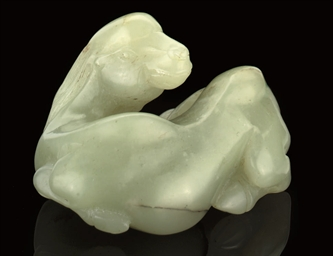 A CELADON JADE MODEL OF A CAME