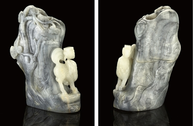A GREY AND WHITE JADE VASE, 18