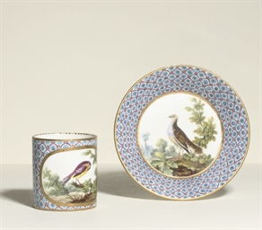 A SEVRES COFFEE-CUP AND SAUCER