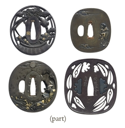 A group of twenty-three tsuba