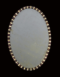 AN IRISH GEORGE III OVAL MIRRO