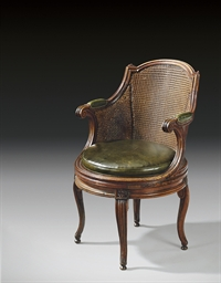 A LATE LOUIS XV WALNUT FAUTEUI