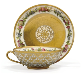 A SEVRES GOLD-GROUND CUP AND S