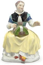 A MEISSEN FIGURE OF THE LACE M