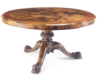 A FIGURED WALNUT CIRCULAR BREA
