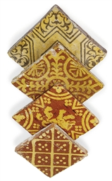 FOUR SLIPWARE-DECORATED TILES