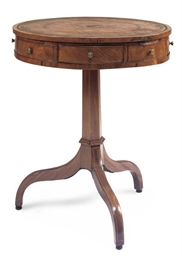 A MAHOGANY DRUM TABLE
