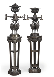 A NEAR PAIR OF BRONZE THREE-LI