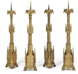 A SET OF FOUR GILT-BRASS CANDL