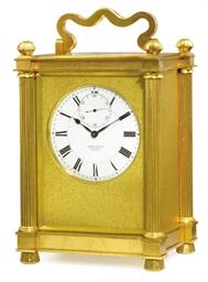 A Victorian gilt-brass timepie