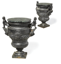 A PAIR OF FRENCH CAST IRON URNS