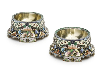 A pair of silver-gilt salt and