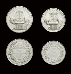 Two silver commemorative medal