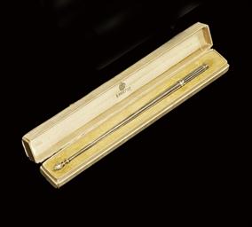 A silver pen-holder