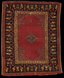 A SMALL MEDALLION USHAK RUG