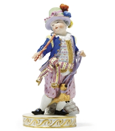 A MEISSEN FIGURE OF A BOY WITH