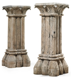 A PAIR OF CARVED STONE CLUSTER