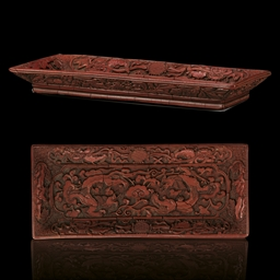 A FINELY CARVED MING CINNABAR